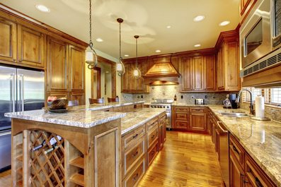 Universal Design features in this kitchen - levered handles, single faucetry, varying counter heights, LED lighting, task lighting, and pull out cabinets.