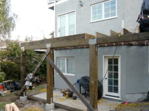 Framing for an overhang on a new deck area building job